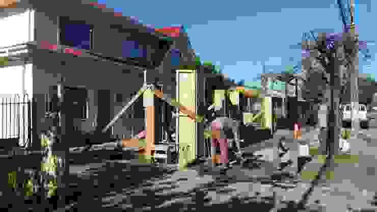 Cierre hormigon metal madera de ARQUITECTURA E INGENIERIA PUNTAL LIMITADA Ecléctico