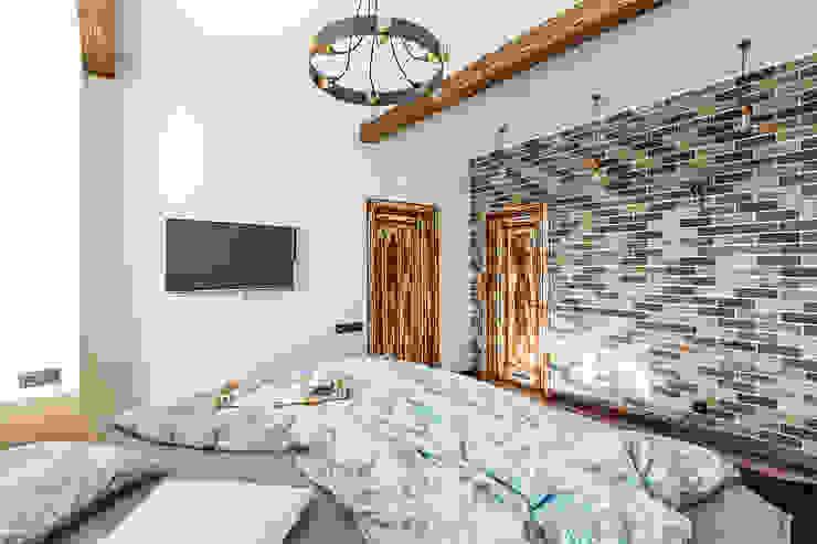 Camera da letto in stile industriale di archstudio_bb Industrial