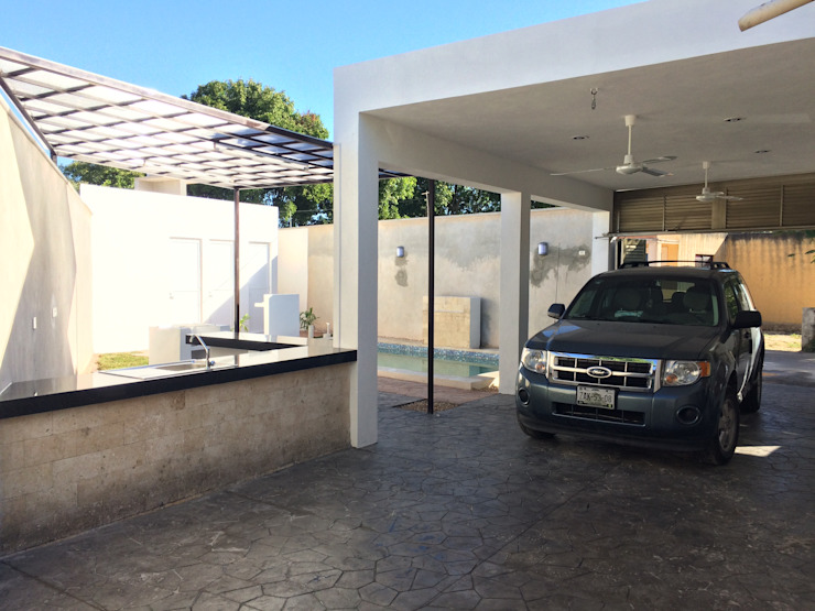 Garaje Garajes de estilo moderno de Atelier U + M Moderno Piedra