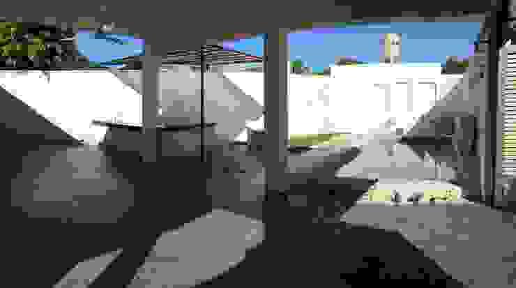 Terraza 2 Balcones y terrazas de estilo moderno de Atelier U + M Moderno Concreto