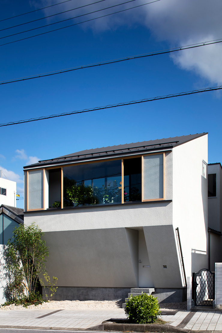 Eclectic style houses by 井上久実設計室 Eclectic