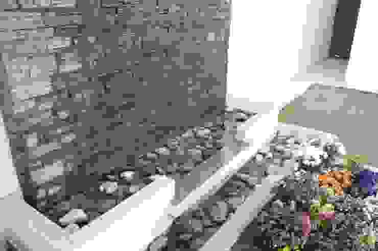 Jardines de estilo  por Daniel Teyechea, Arquitectura & Construccion, Moderno