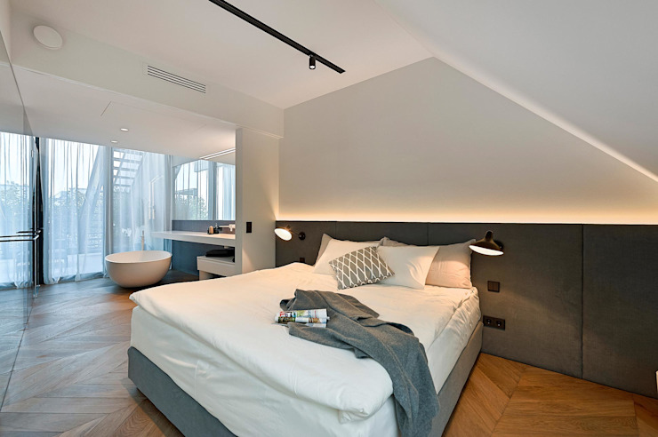 Attico G 43/13: Camera da letto in stile  di FADD Architects