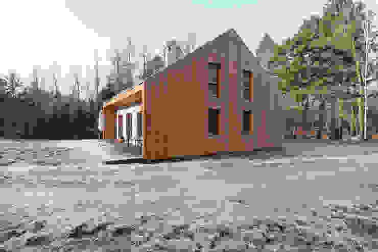 Дома в стиле модерн от KOZIEJ ARCHITEKCI Модерн