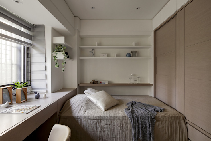 與陽光的約會:  臥室 by 大荷室內裝修設計工程有限公司