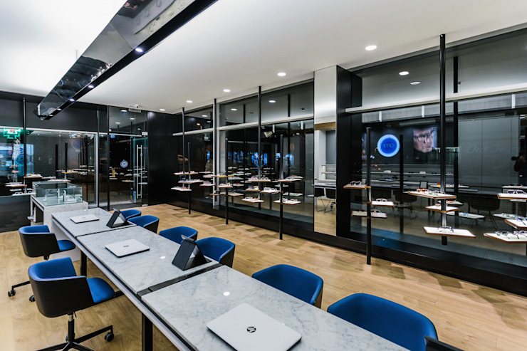 11 Lojas e Espaços comerciais modernos por XYZ Arquitectos Associados Moderno