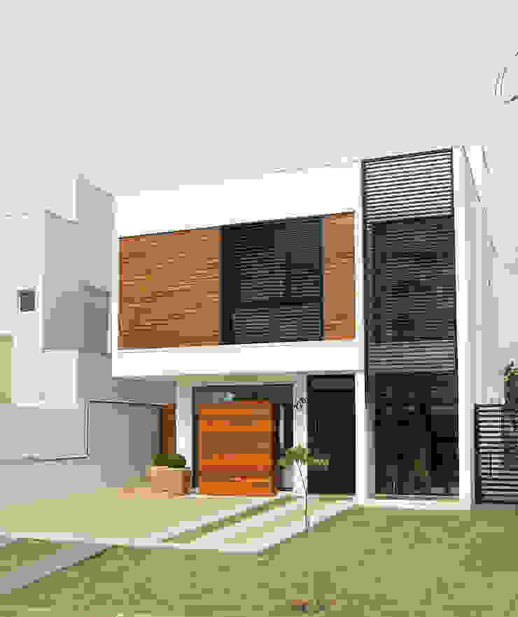 Casas modernas: Ideas, imágenes y decoración de Taguá Arquitetura Moderno Madera Acabado en madera