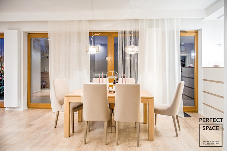 Modern dining room by Perfect Space Modern