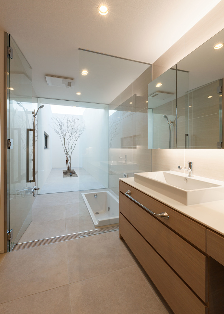 Banheiros minimalistas por Architet6建築事務所 Minimalista Pedra