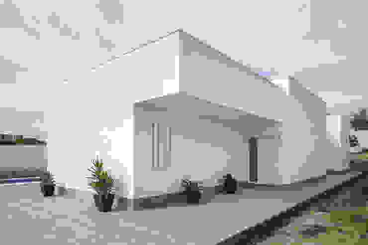 Casas minimalistas por FAQ arquitectura Minimalista