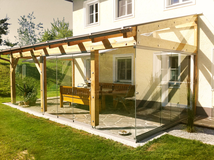 Schmidinger Wintergärten, Fenster & Verglasungen Modern style conservatory Wood Brown