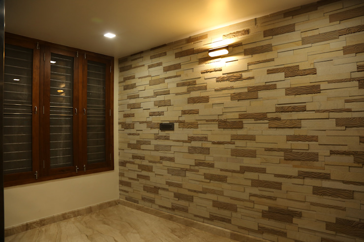 Lobby wall with stone cladding Modern houses by Hasta architects Modern