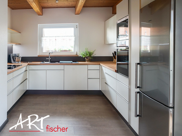 Modern style kitchen by ARTfischer Die Möbelmanufaktur. Modern Wood Wood effect