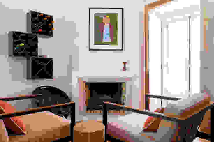 Sala Comum_Zona da Lareira por Traço Magenta - Design de Interiores Moderno