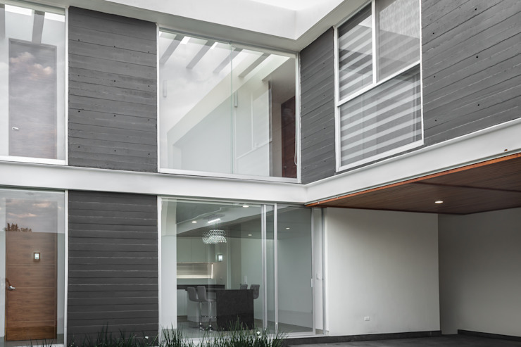 SICOMOROS UNO CERO SIETE Balcones y terrazas modernos de GENETICA ARQ STUDIO Moderno