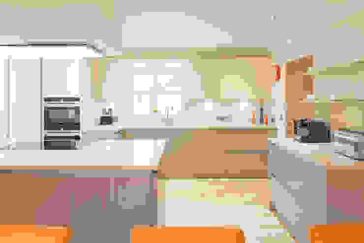 Modern German White Kitchen:  Kitchen by Woollards of Mildenhall,