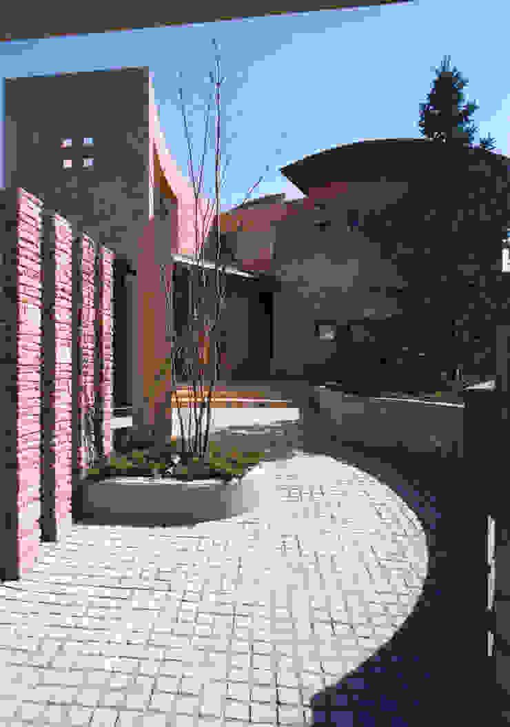 Casas de estilo mediterráneo de 豊田空間デザイン室 一級建築士事務所 Mediterráneo Piedra