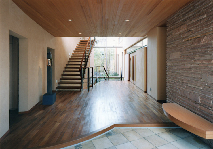 Mediterranean style corridor, hallway and stairs by 豊田空間デザイン室 一級建築士事務所 Mediterranean Wood Wood effect