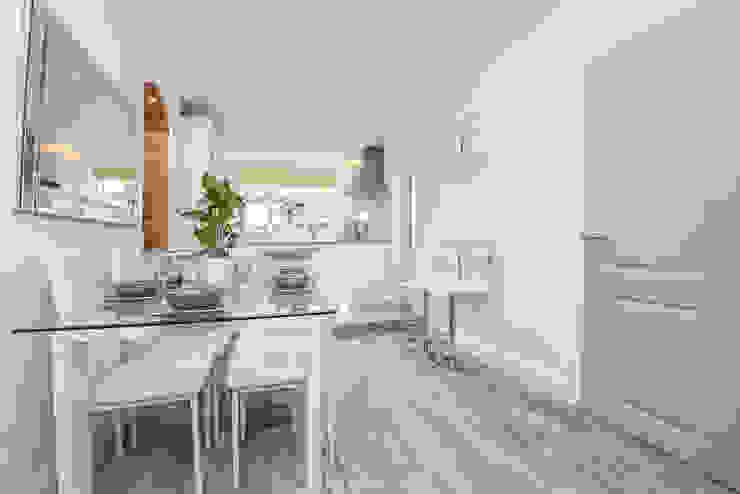 Kitchen Millennium Interior Designers Modern style kitchen Ceramic White