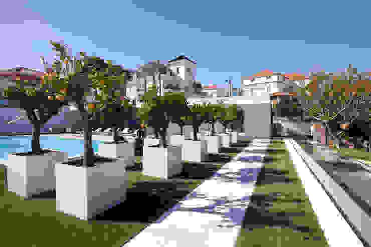 MORADIA MONTE ESTORIL Casas modernas por fernando piçarra fotografia Moderno