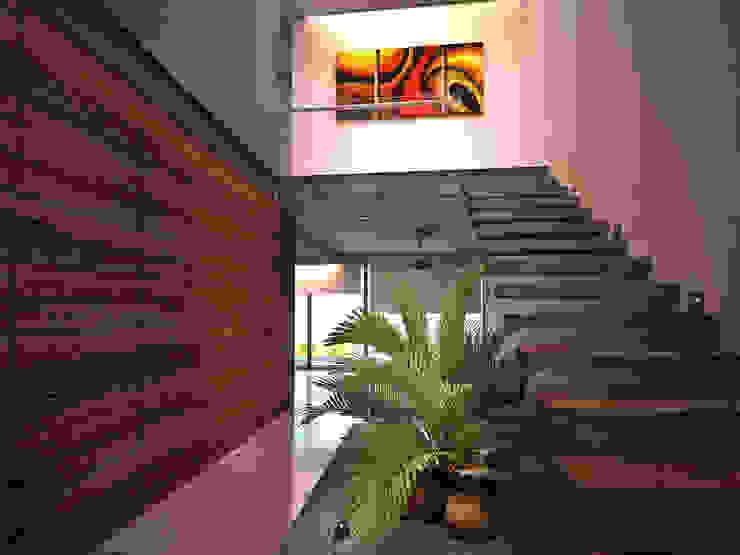 Modern corridor, hallway & stairs by Art.chitecture, Taller de Arquitectura e Interiorismo 📍 Cancún, México. Modern Ceramic