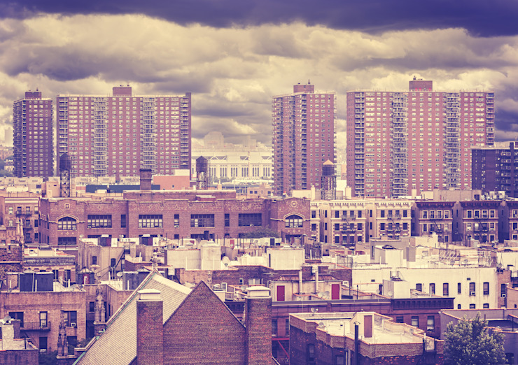 Vintage toned photo of New York residential buildings in rainy day, Harlem, USA. by homify