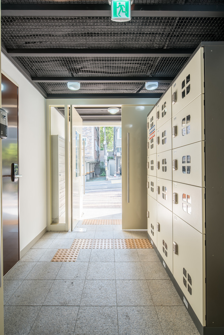 Hoteles de estilo moderno de 큐브디자인 건축사사무소 Moderno