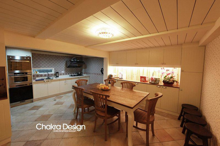 Country style kitchen by 七輪空間設計 Country