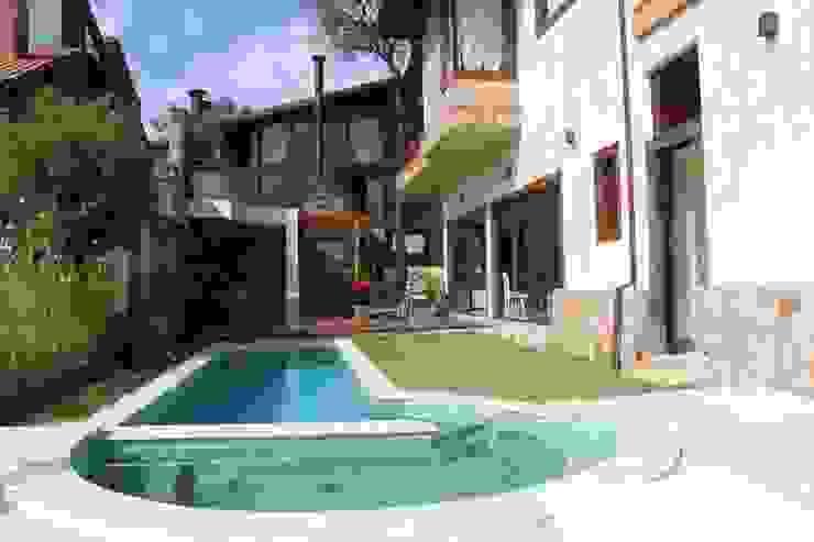 Jardines de estilo rústico de Barros e Zanolini Arquitetura e construção Rústico