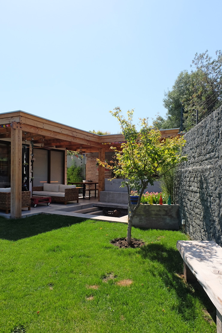 ESTUDIO BASE ARQUITECTOS Rustikaler Garten
