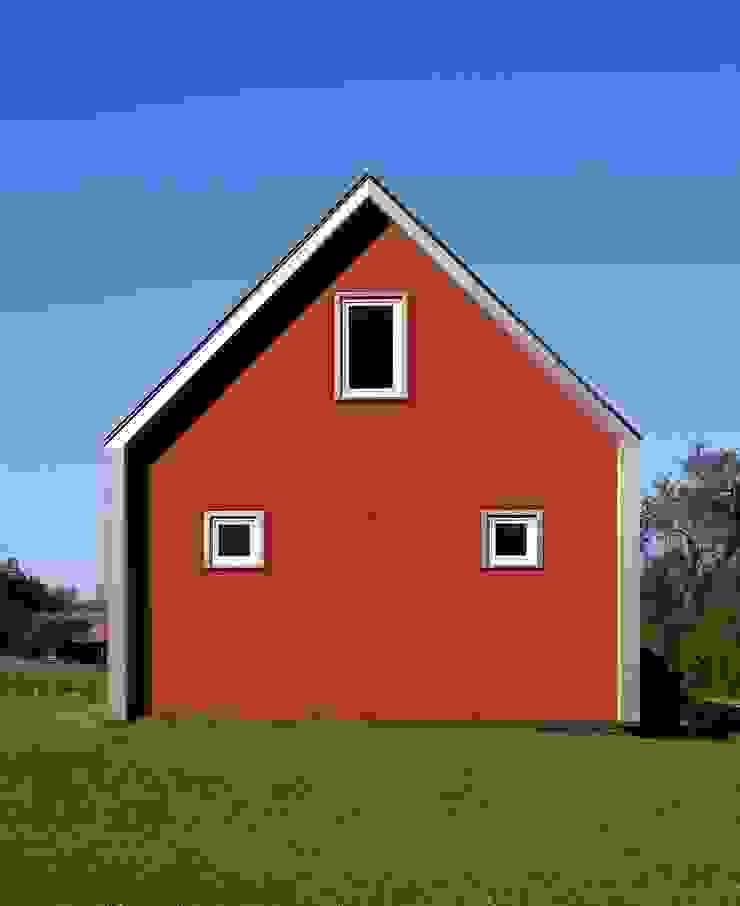 Fiber cement panels, east elevation ZeroEnergy Design Modern houses Red