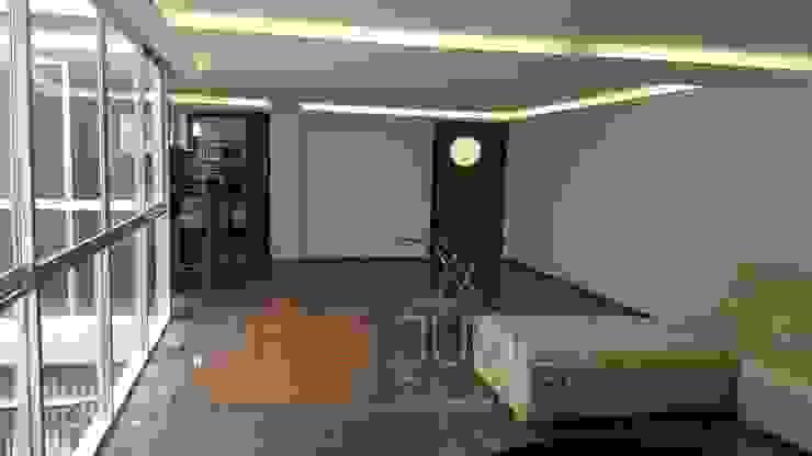 Remodelación departamento Paredes y pisos de estilo moderno de Juvier SA de CV Moderno Mármol