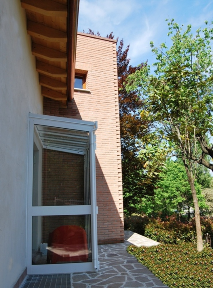 La bussola termica verso il giardino di Studio d'Architettura TAUNISIO Eclettico