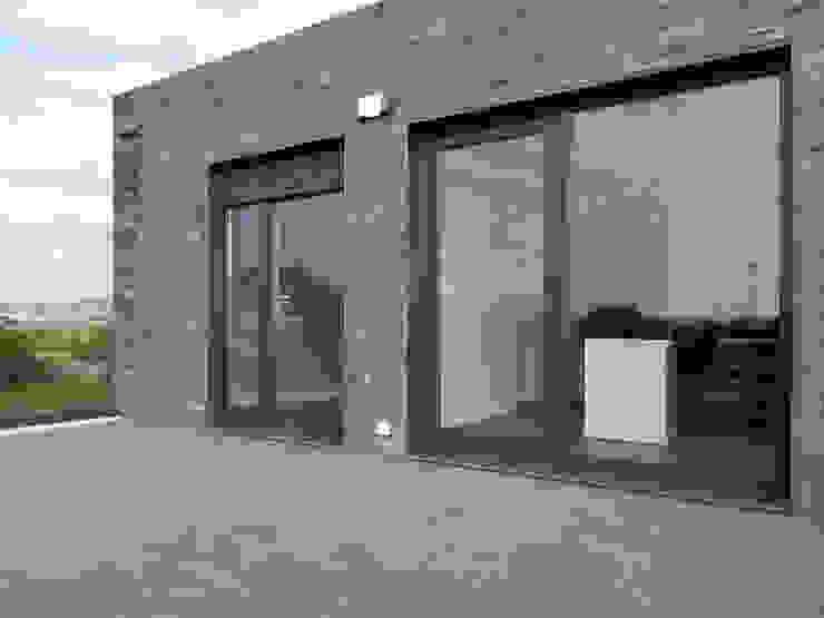 Terrazas de estilo  por Casas Cube,