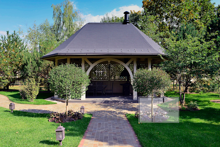 Jardines de estilo  de Архитектурная Мастерская Георгия Пряничникова