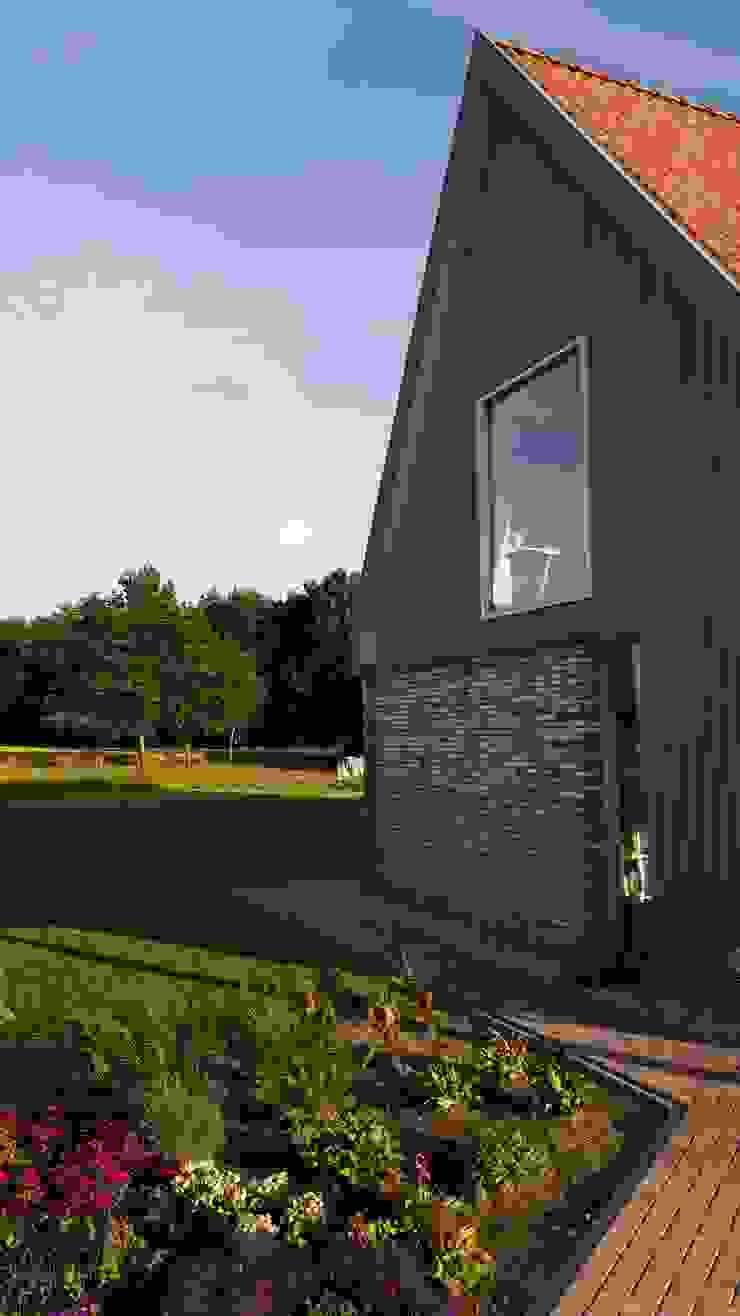 Vrijstaande woning in het landschap Moderne huizen van Architectenbureau Jules Zwijsen Modern