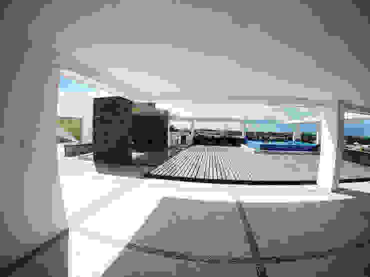 Casa Tunich Jardines modernos de Grupo Cerma Moderno