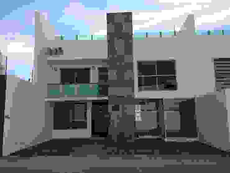 Fachada Casa en San Francisco huatengo Tulancingo Navecsa Constructora Casas de estilo minimalista Concreto Blanco