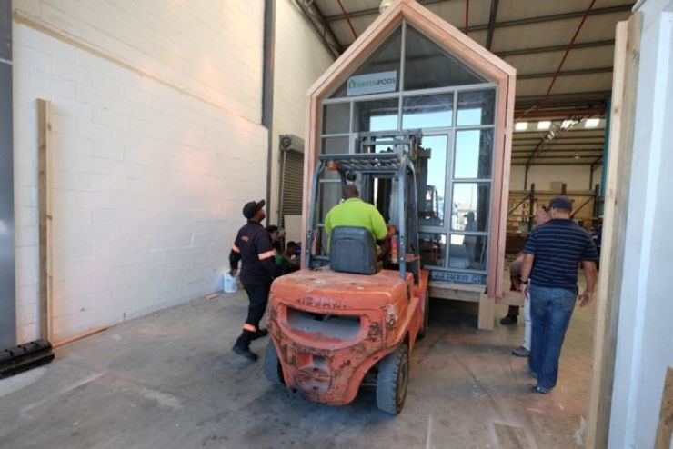 Moving the pod out of the factory:   by Greenpods