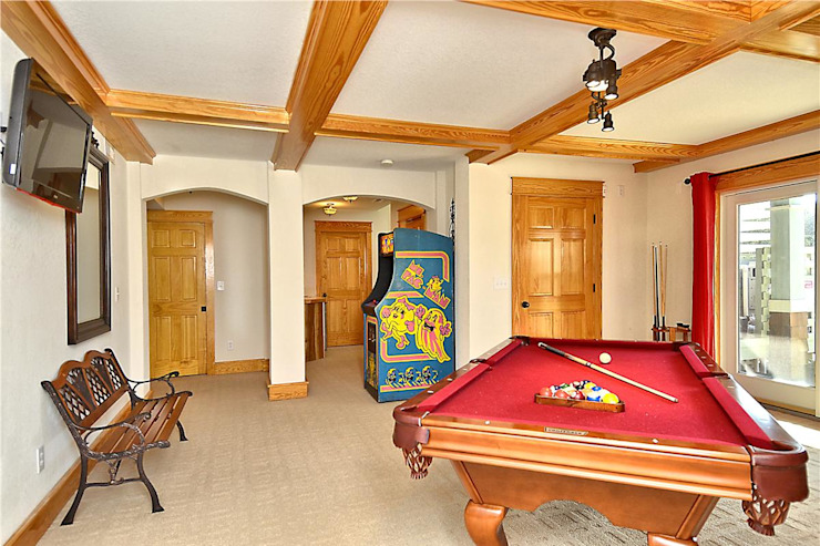 game room with pool table and arcade Modern Media Room by Outer Banks Renovation & Construction Modern