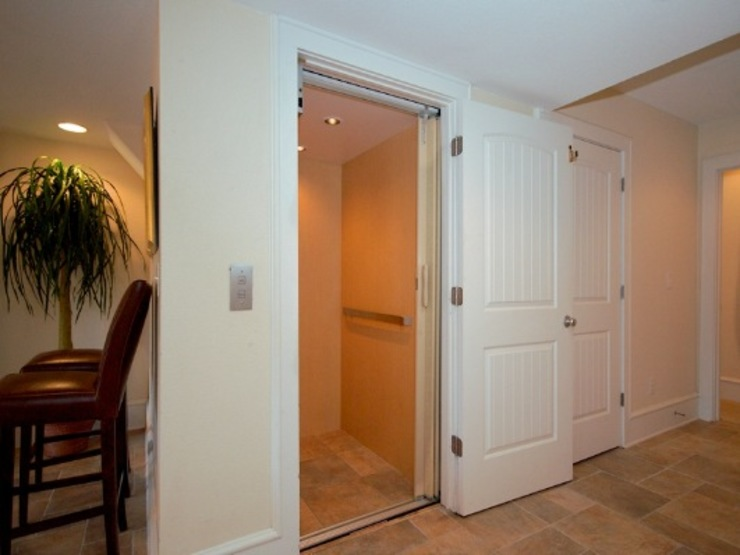 Indoor Elevator Modern Corridor, Hallway and Staircase by Outer Banks Renovation & Construction Modern
