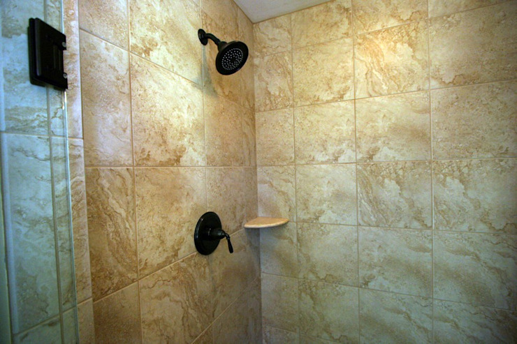 Bathroom uses Mosaic tile of Natural Stone Modern bathroom by Outer Banks Renovation & Construction Modern