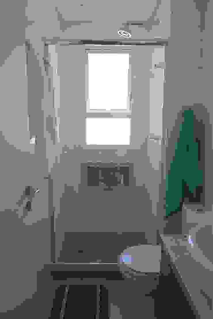 WC Banheiros modernos por In.home Moderno