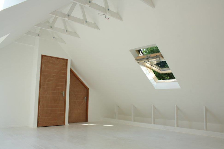 Loft room , staircase and Velux roof windows Modern style bedroom by Loftspace Modern