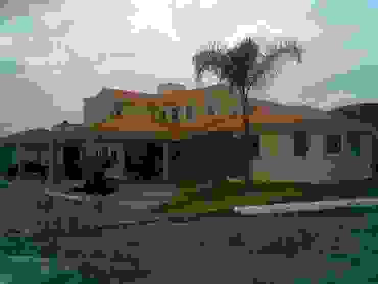 CASA F8 de SG Huerta Arquitecto Cancun Clásico Caliza