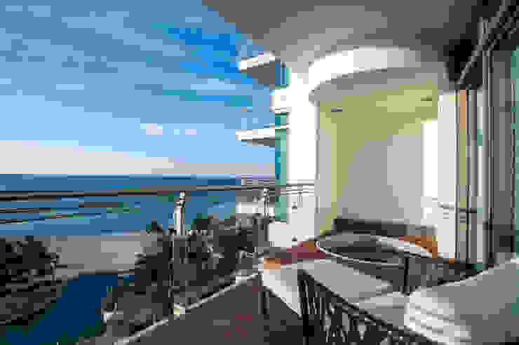 LAS OLAS Balcones y terrazas modernos de Art.chitecture, Taller de Arquitectura e Interiorismo 📍 Cancún, México. Moderno