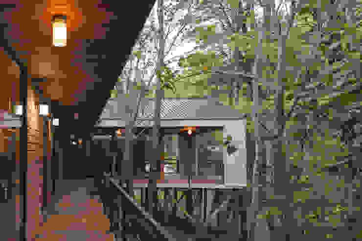 Casa L Casas de estilo rústico de Ciclo Arquitectura Rústico Madera Acabado en madera
