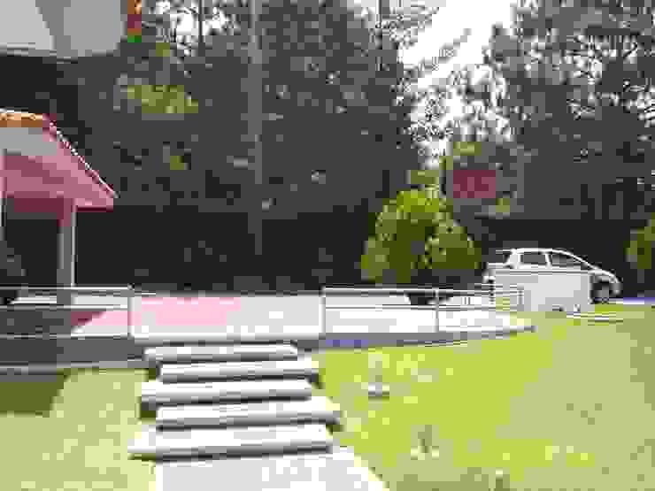 CASA WILMA Jardines clásicos de SG Huerta Arquitecto Cancun Clásico Piedra