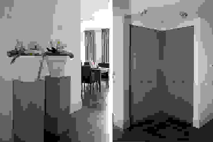 Zichtlijn naar de eetkamer. Moderne woonkamers van Doreth Eijkens | Interieur Architectuur Modern