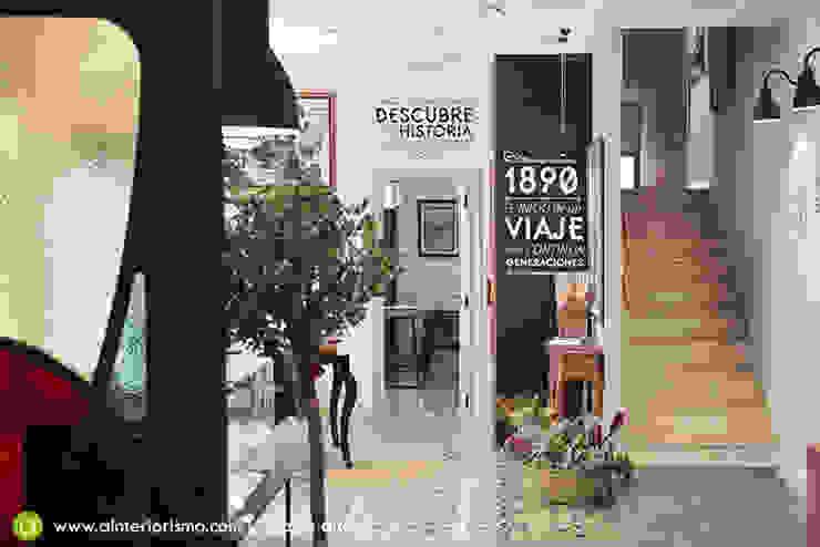 Diseño y decoración de entrada a oficinas Pasillos, vestíbulos y escaleras de estilo moderno de A interiorismo by Maria Andes Moderno Cerámico